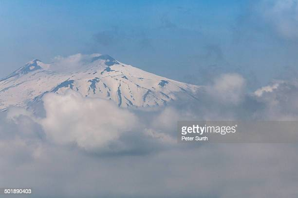 Mt Etna, enveloped by clouds, Sicily, Italy