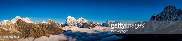 Mt Everest peaks panorama Himalayan mountain range above the clouds