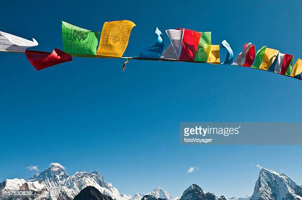 Mt Everest summit vibrant buddhist prayer flags flying blue sky