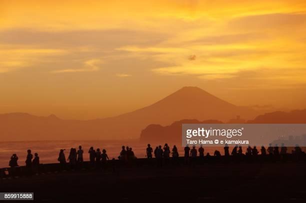 Mt. Fuji and people on the sunset beach in Kamakura city in Kanagawa prefecture in Japan