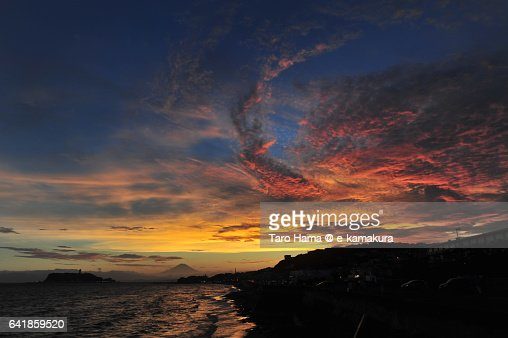 Mt. Fuji and red colored cloud on the beach in Kamakura