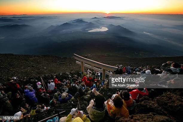 Mt Fuji climbers watch the sunrise on August 12 2007 in Japan Mt Fuji is recommended to be registered as World Heritage site