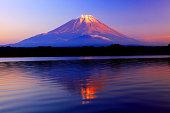 Mountain Fuji at winter morning with reflection on the lake Kawaguchi, Japan
