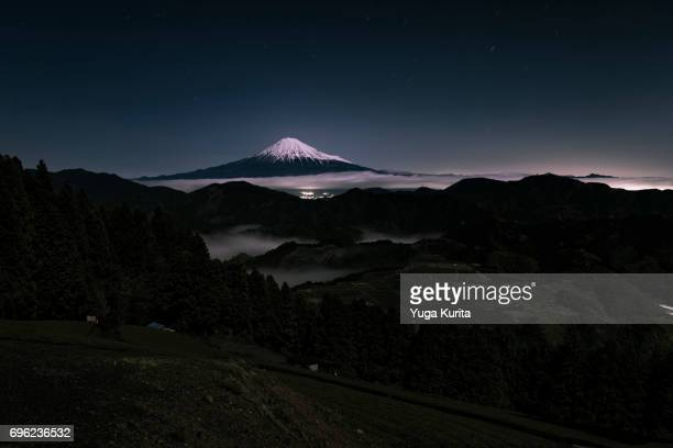 Mt. Fuji Over a Sea of Clouds at Night