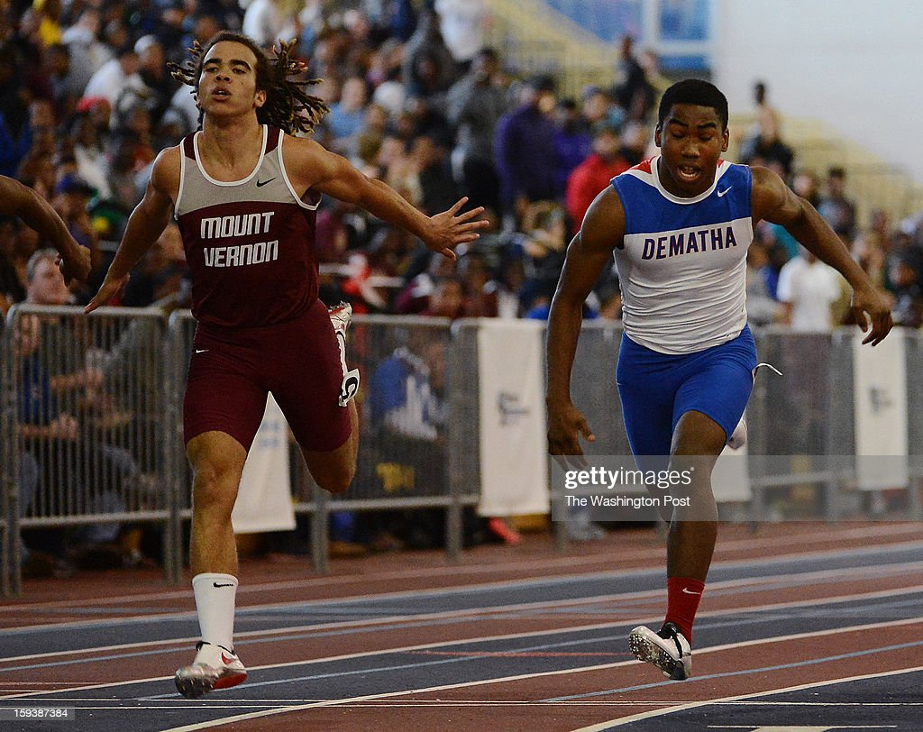 Mt. Vernon's Michael-Thomas Brown, left, just out DeMatha's Darryl Haraway for the win at the finish during the Montgomery Invitational Track and Field Championships at the Prince Georges County Sports and Learning Complex on Saturday, January 12, 2013.