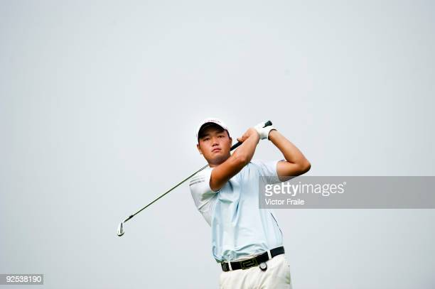 Mu Hu of China plays a shot during the day two of Asian Amateur Championship at the Mission Hills Golf Club on October 30 2009 in Shenzhen Guangdong...