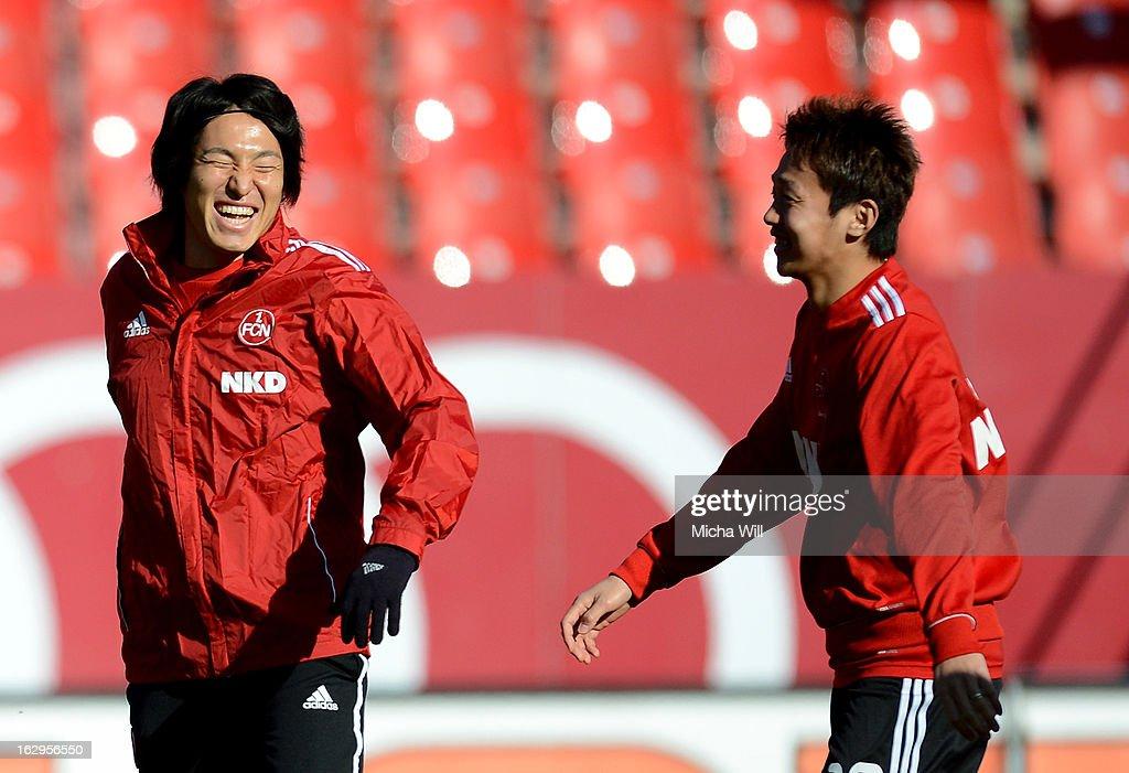 Mu Kanazaki (L) and Hiroshi Kiyotake of Nuernberg warm up before the Bundesliga Match between 1. FC Nuernberg and SC Freibug at Grundig Stadion on March 2, 2013 in Nuremberg, Germany.