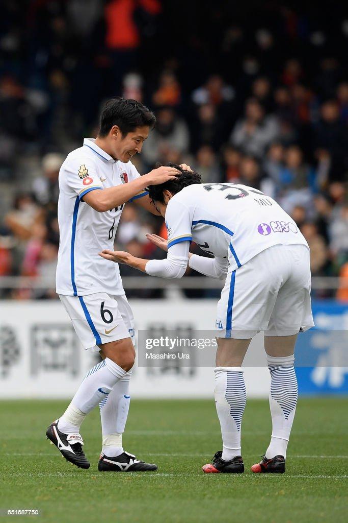 Mu Kanazaki (R) and Ryota Nagaki (L) of Kashima Antlers ceolebrate their 3-2 win in the J.League J1 match between Shimizu S-Pulse and Kashima Antlers at IAI Stadium Nihondaira on March 18, 2017 in Shizuoka, Japan.