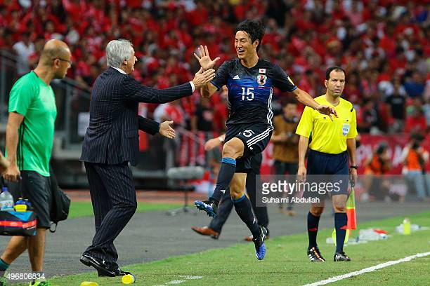 Mu Kanazaki of Japan celebrates with head coach Vahid Halilhodzic after scoring the first goal during the 2018 FIFA World Cup Qualifier match between...
