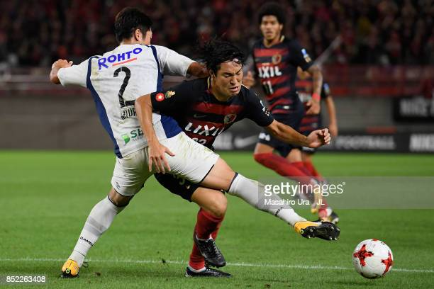 Mu Kanazaki of Kashima Antlers and Genta Miura of Gamba Osaka compete for the ball during the JLeague J1 match between Kashima Antlers and Gamba...