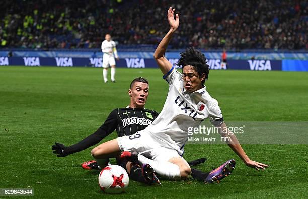 Mu Kanazaki of Kashima Antlers and Mateus Uribe Villa of Atletico Nacional in action during the FIFA Club World Cup Semi Final match between Atletico...