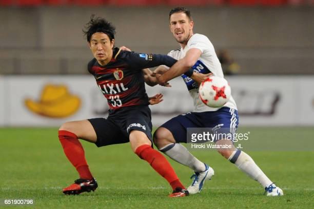 Mu Kanazaki of Kashima Antlers and Milos Degenek of Yokohama FMarinos compete for the ball during the JLeague J1 match between Kashima Antlers and...