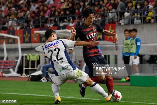 Mu Kanazaki of Kashima Antlers and Oh Jae Suk of Gamba Osaka compete for the ball during the JLeague J1 match between Kashima Antlers and Gamba Osaka...
