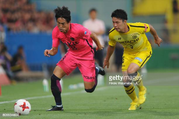 Mu Kanazaki of Kashima Antlers and Yuta Nakayama of Kashiwa Reysol compete for the ball during the JLeague J1 match between Kashiwa Reysol and...