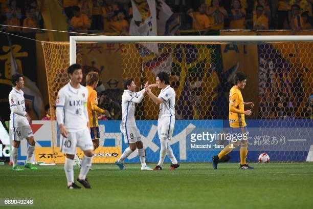 Mu Kanazaki of Kashima Antlers celebrates scoring his side's second goal with his team mate Shoma Doi during the JLeague J1 match between Vegalta...