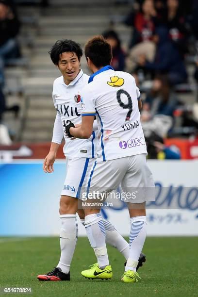 Mu Kanazaki of Kashima Antlers celebrates scoring his side's third goal with his team mate Yuma Suzuki during the JLeague J1 match between Shimizu...