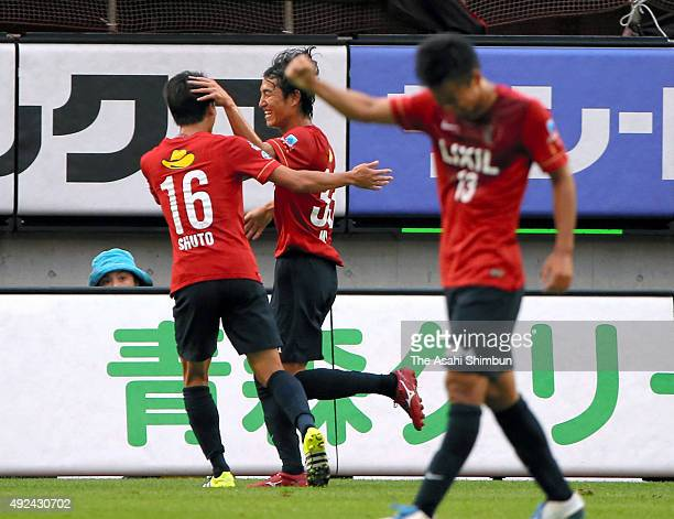 Mu Kanazaki of Kashima Antlers celebrates scoring his team's third goal with his team mates during the JLeague Yamazaki Nabisco Cup semi final second...