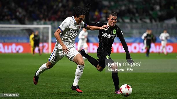 Mu Kanazaki of Kashima Antlers chases Mateus Uribe Villa of Atletico Nacional during the FIFA Club World Cup Semi Final match between Atletico...
