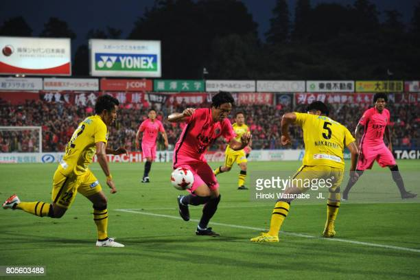 Mu Kanazaki of Kashima Antlers competes for the ball against Naoki Wako and Yuta Nakayama of Kashiwa Reysol during the JLeague J1 match between...