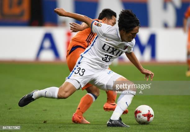 Mu Kanazaki of Kashima Antlers controls the ball under pressure of Kei Koizumi of Albirex Niigata during the JLeague J1 match between Albirex Niigata...