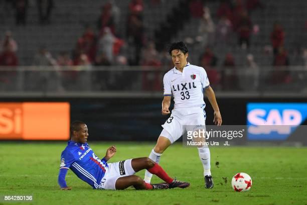 Mu Kanazaki of Kashima Antlers is tackled by Martinus of Yokohama FMarinos during the JLeague J1 match between Yokohama FMarinos and Kashima Antlers...