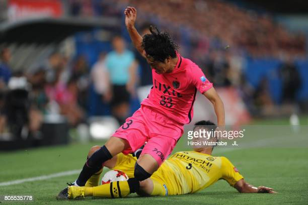 Mu Kanazaki of Kashima Antlers is tackled by Yuta Nakayama of Kashiwa Reysol during the JLeague J1 match between Kashiwa Reysol and Kashima Antlers...