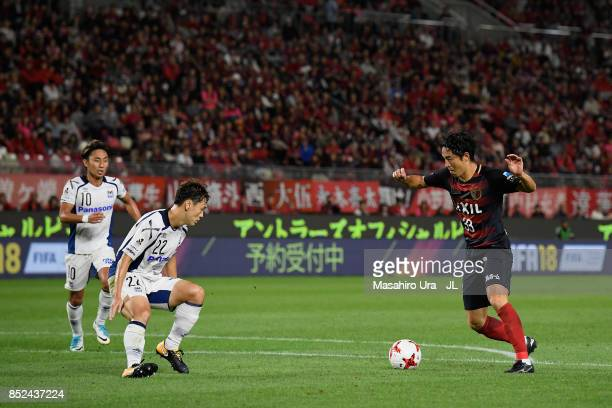 Mu Kanazaki of Kashima Antlers takes on Oh Jae Suk of Gamba Osaka during the JLeague J1 match between Kashima Antlers and Gamba Osaka at Kashima...