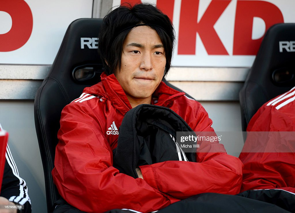 Mu Kanazaki of Nuernberg sits on the substitutes' bench at the start of the Bundesliga Match between 1. FC Nuernberg and SC Freibug at Grundig Stadion on March 2, 2013 in Nuremberg, Germany.