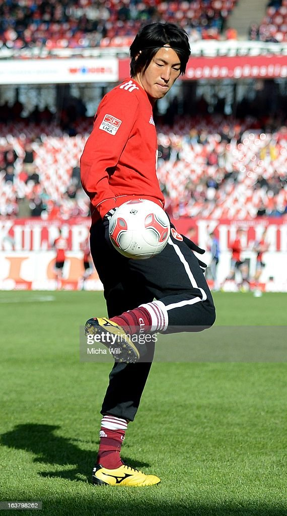 <a gi-track='captionPersonalityLinkClicked' href=/galleries/search?phrase=Mu+Kanazaki&family=editorial&specificpeople=6720023 ng-click='$event.stopPropagation()'>Mu Kanazaki</a> of Nuernberg warms up prior to the Bundesliga match between 1. FC Nuernberg and FC Schalke 04 at Grundig-Stadion on March 16, 2013 in Nuremberg, Germany.
