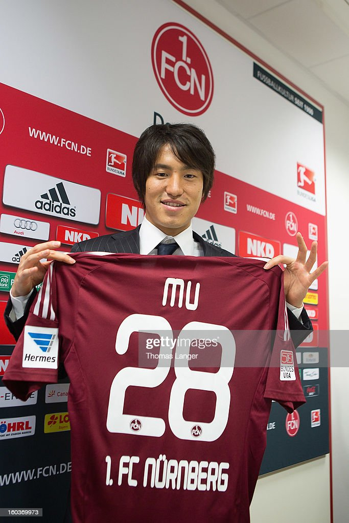 Mu Kanazaki poses after a press conference presenting him as a newly signed player to 1. FC Nuernberg on January 30, 2013 at the Sportpark Valznerweiher in Nuremberg, Germany.