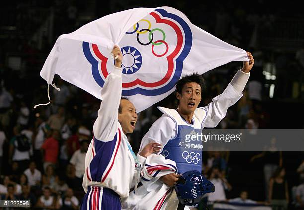 Mu Yen Chu of Chinese Taipei celebrates with his coach after winning the gold medal with his defeat of Oscar Francisco Salazar Blanco of Mexico in...