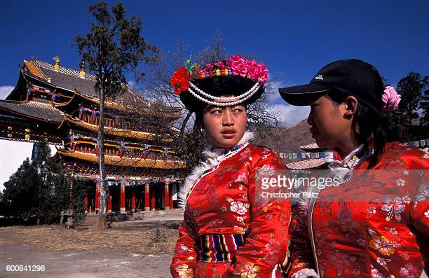 Mu Ze Latso with a friend also from the Mo Suo minority visit the Buddhist temple in Yongning town north west Yunnan Province close to Tibetan and...