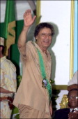 Muammar Gaddafi President of Libya waves in 2001 during the 32nd anniversary of the revolution