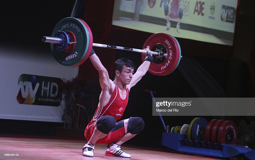 Muammer Sahin of Turkey A competes in the Men's 56kg during day one of the 2013 Junior Weightlifting World Championship at Maria Angola Convention Center on April 04, 2013 in Lima, Peru.