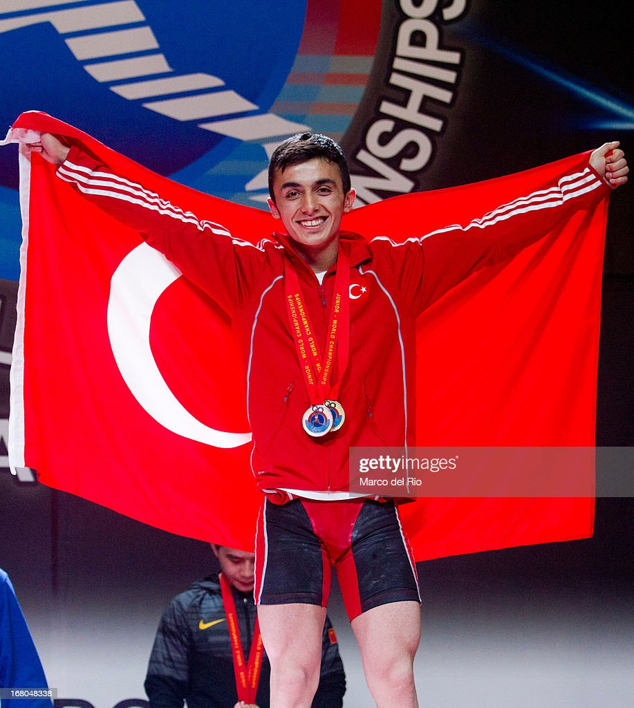 Muammer Sahin of Turkey celebrates in the podium of Men's 56kg during day one of the 2013 Junior Weightlifting World Championship at Maria Angola Convention Center on April 04, 2013 in Lima, Peru.