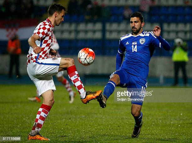 Muanes Dabbur of Israel competes for the ball with the Milan Badelj of Croatia during the International Friendly match between Croatia and Israel at...