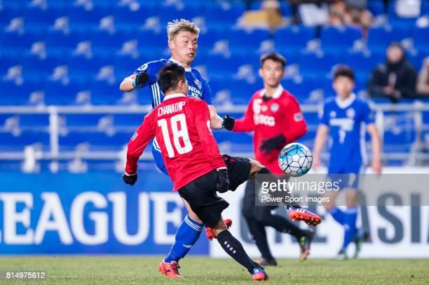 Muangthong Midfielder Chanathip Songkrasin in action against Ulsan Hyundai Forward Lee Jongho the AFC Champions League 2017 Group E match between...