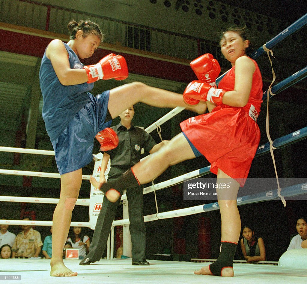 Muay Thai female boxers exchange kicks in the ring May, 2000 at a recent fight at Rangsit stadium in Bangkok, Thailand.