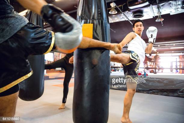 Muay Thai workout - Motivational training at the gym facility