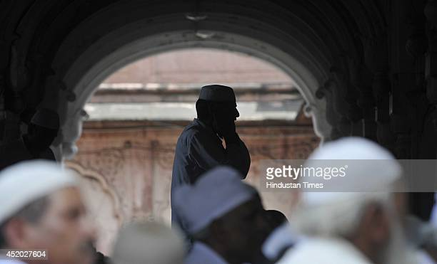 A muazzin giving call for second Friday prayer of Holy month of Ramadan at Moti Masjid on July 11 2014 in Bhopal India During Ramadan muslims refrain...