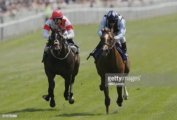 Mubaashir ridden by Frankie Dettori beats Mind The Style ridden by Robert Miles to win the Joseph Heler Cheese Lily Agnes Conditions Stakes during...