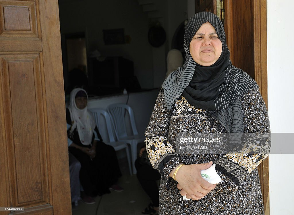 Mubarka Brahmi, the wife of opposition politician Mohamed Brahmi, mourns at their house in Ariana, outside Tunis, after Brahmi was gunned down in front of his home on July 25, 2013. Tunisia marked a day of mourning after gunmen killed Brahmi, sparking fresh political turmoil, protests and a general strike which took Tunis to near standstill.