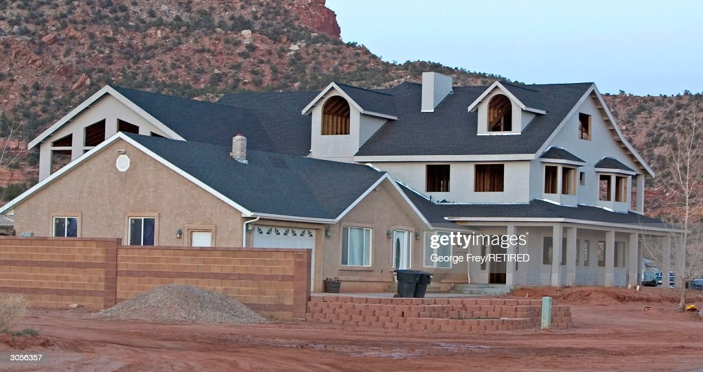 A much larger addition to a smaller house is being built in Colorado City Arizona the home of the Fundamentalist Church of Jesus Christ of Latter Day...