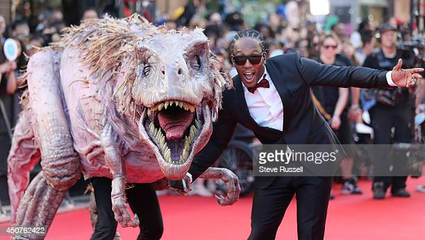 TORONTO ON JUNE 15 Much Music VJ TRexXx greets a TRex at the Much Music Video Awards at MuchMusic on Queen Street West in Toronto June 15 2014