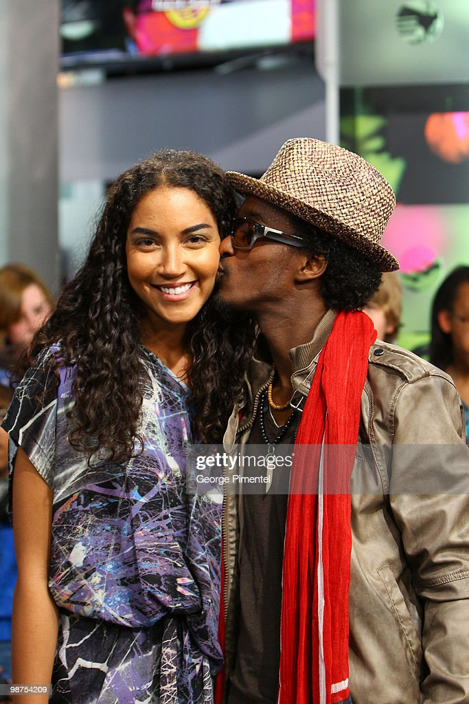 MuchMusic VJ Sarah Taylor with singer K'naan on the set of MuchOnDemand at the MuchMusic HQ on April 29, 2010 in Toronto, Canada.