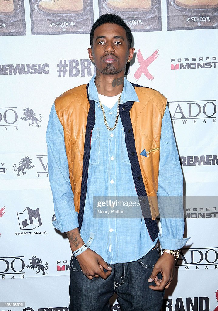 Mucho Dinero attends Brand X Live with Eric Bellinger at the El Rey Theatre on December 19, 2013 in Los Angeles, California.