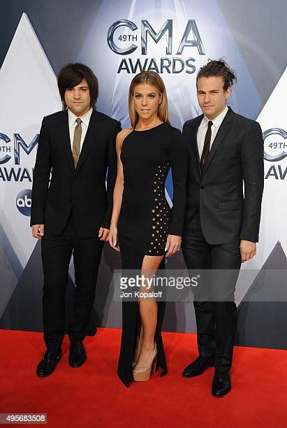 Mucisians Neil Perry Kimberly Perry and Reid Perry of The Band Perry attends the 49th annual CMA Awards at the Bridgestone Arena on November 4 2015...