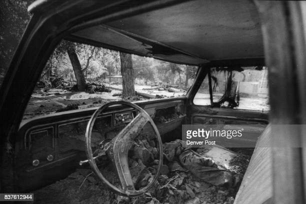 Mud and leaves dry out inside a wrecked truck along Big Thompson river Tuesday The truck was found in a campground following the disastrous flood in...