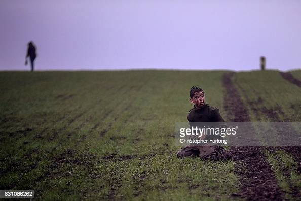 A mud covered boy catches his breath after wrestling in the fields for the hessian Hood during the junior Haxey Hood game at Haxey Village on January...