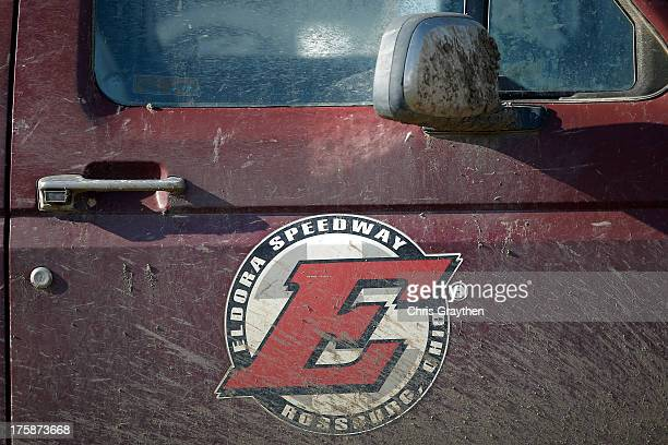 A mud covered logo is seen on a truck during practice for the NASCAR Camping World Truck Series inaugural CarCash Mudsummer Classic at Eldora...